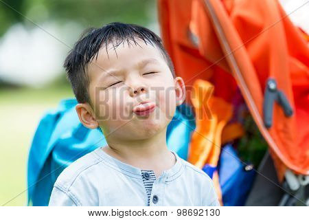 Small kid showing his tongue to make a funny face