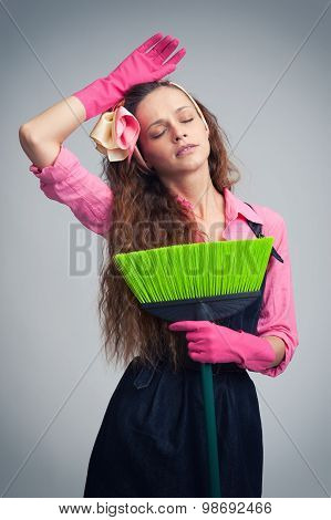 Tired Housewife With Broom