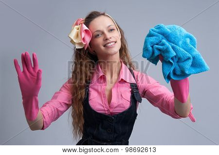 Laughing Woman Wiping With A Blue Rag