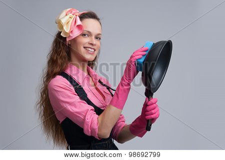 Housewife Cleaning A Cooking Pan