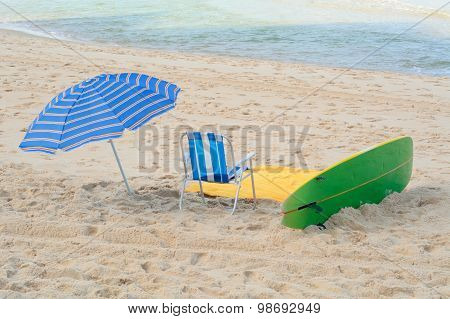 Umbrella, Chair And Surf Board