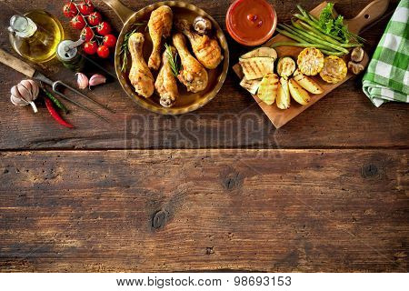 Grilled chicken drumsticks with vegetables