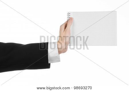 Business And Reporter Topic: The Hand Of A Journalist In A Black Suit Holding A Notebook With A Penc