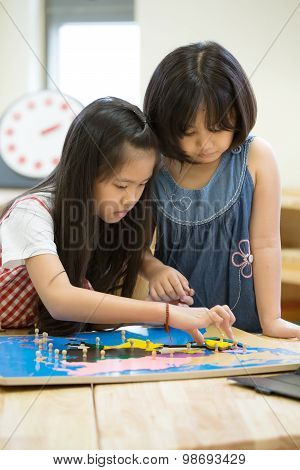 Little Asian Girl Looking South America Asia For Play Jigsaw