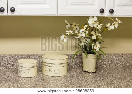 Tins And Flowers On Kitchen Counter