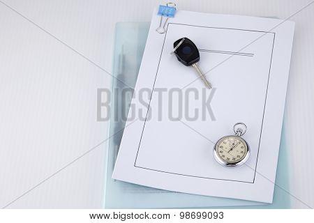 car key and car loan document