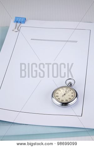 loan application document and stop watch