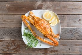 stock photo of cooked crab  - Top view cooked delicious hot and spicy sauce blue crab on white plate - JPG