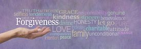 foto of forgiveness  - Female hand outstretched with palm up and the word Forgiveness hovering above surrounded by a relevant word cloud on a lilac colored stone effect background - JPG