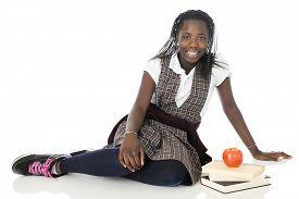 image of tween  - A happy tween schoolgirl relaxed on the floor in her school uniform - JPG