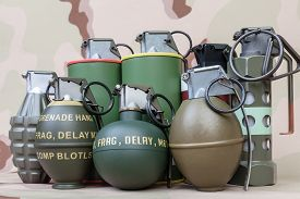 foto of grenades  - All explosives weapon armystandard time fuze hand grenade on camouflage background - JPG