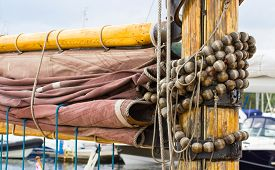 picture of sails  - Yachting parts of old wooden sailboat in port of sailing coiled rope sail details of yacht - JPG