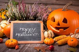 image of carving  - Halloween still life with pumpkins and Halloween holiday text - JPG
