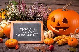 image of halloween  - Halloween still life with pumpkins and Halloween holiday text - JPG