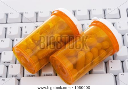 Keyboard With A Pills And Pill Bottle