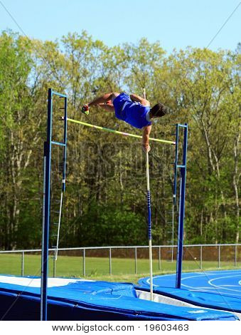 male pole vaulting at a track and field competition