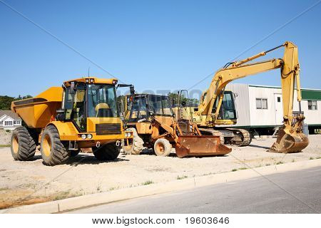 Heavy construction equipment at work site