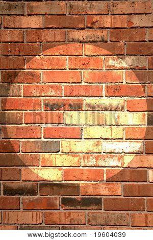 Brick wall with center spot light
