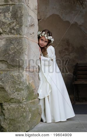 A beautiful young girl dressed as a medieval princess