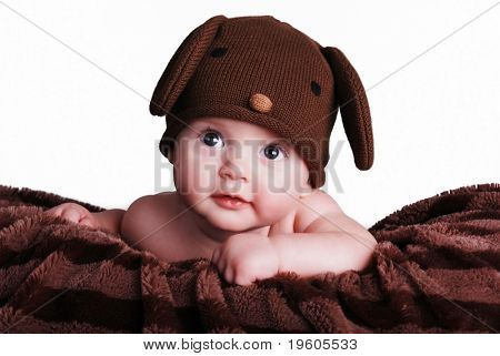 A cute baby boy wearing a puppy hat