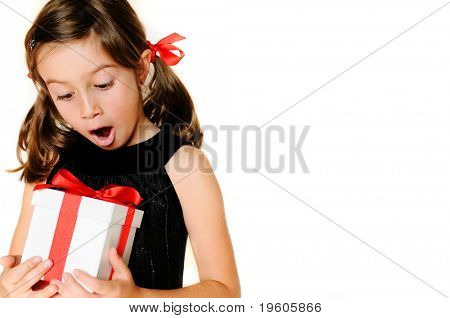 A cute girl excited about a gift, copy space