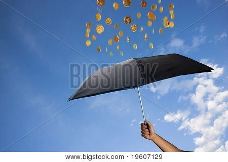 Coins Are Raining Over An Umbrella