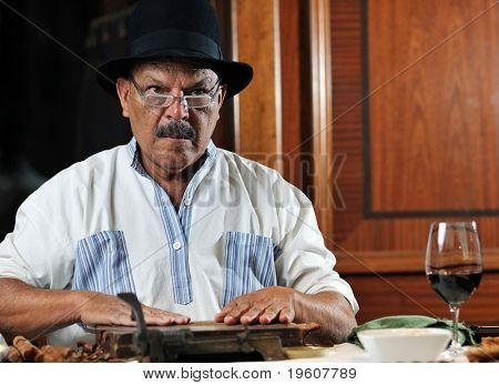 older senior man making luxury handmade cuban cigar