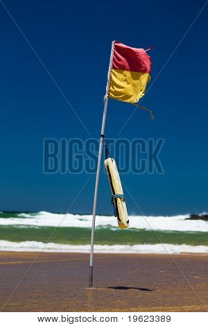 Surf lifesaving flag on beach