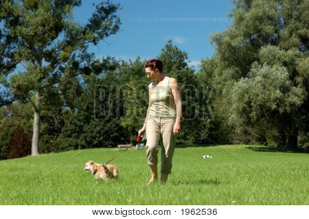 Senior Woman Walks Her Dog