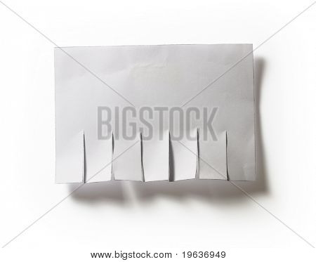 Closeup of sticked advertisement template. Isolated on white background with light shadow.