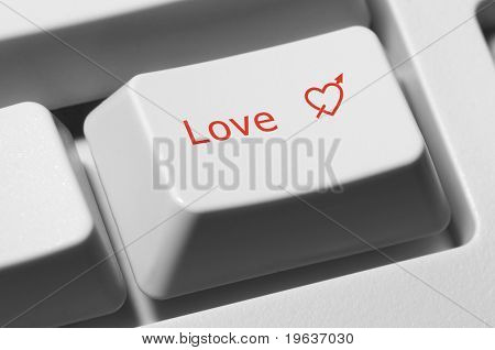"Closeup of keyboard key with text ""Love"" and red heart"