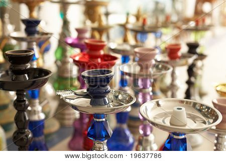 Different hookahs - asian street marketplace. Shallow focus depth