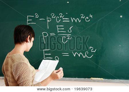 Woman Writing Formula At The Desk