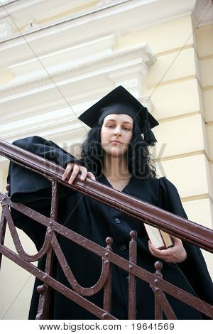 Young Student In Gown Near The University