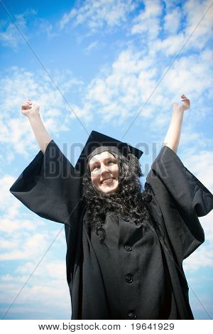 Happy Graduate Student In Cloak With Open Risen Arms