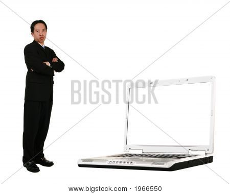 Stand Beside Laptop With Blank Screen