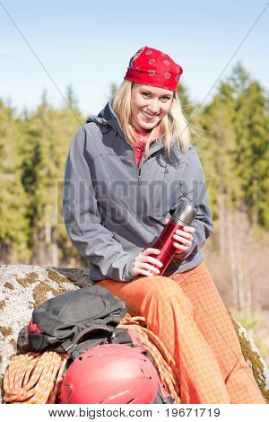 Active Woman Rock Climbing Relax With Thermosbottle