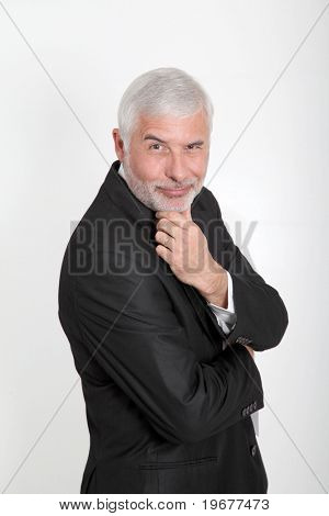Portrait of businessman with hand on chin