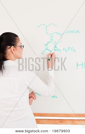 Scientist Writing A Formula On A Chalkboard
