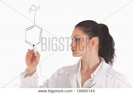 Isolated Woman Writing A Formula On A White Board