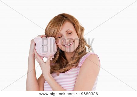 Cute Woman Happy With Her Piggybank