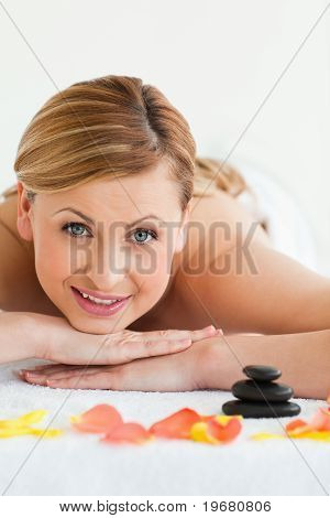 Beautiful Blond-haired Woman Looking At The Camera While Lying Down