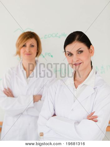 Two Scientists Posing In Front Of A White Board