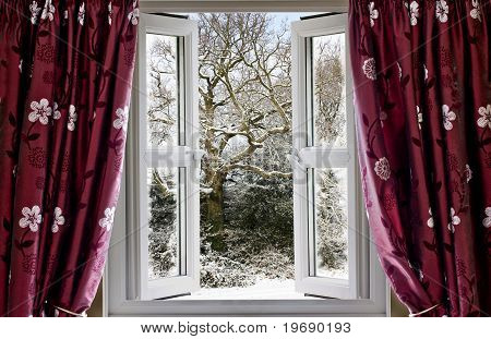 Open window with view to a snowy winter scene