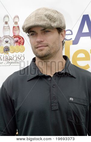 TARZANA, CA - APRIL 18: Scott Elrod arrives at the 8th annual