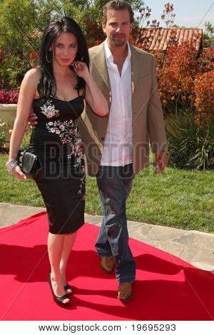 LOS ANGELES  JULY 11: Alissa Sutton & Paulo Benedeti arrive at the Birgit C. Muller Fashion Show at Chaves Ranch on July 11, 2010 in Los Angeles, CA