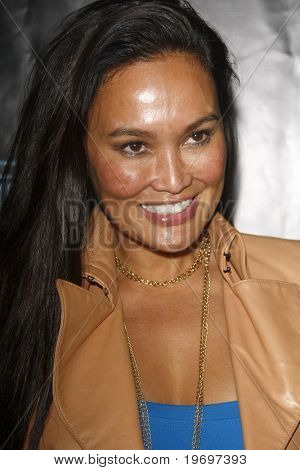 SAN DIEGO - JUL 23:  Tia Carrere at  the Tron' MySpace Party during the 2010 Comic-Con  at Flynn's Arcade on July23, 2010 in San Diego, CA.