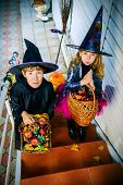 Happy children in a costumes of witches and wizards celebrating halloween. Trick or treat. Halloween poster