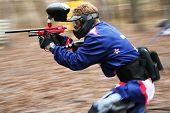 stock photo of paintball  - The running person with a gun for paintball