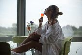 Beautiful Young Woman At Window. Sexy Girl Morning With Glass Of Wine At Window. Woman Near Window. poster